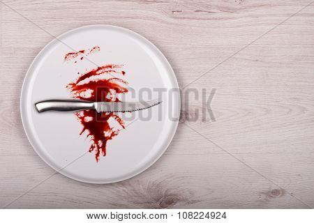 Knife On White Plate With Blood, Wooden Background