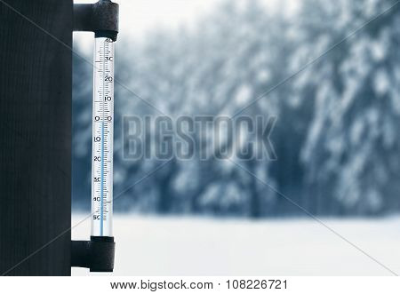 Meteorology, Forecasting And Winter Weather Season Concept - Thermometer On Glass Window With Blurre