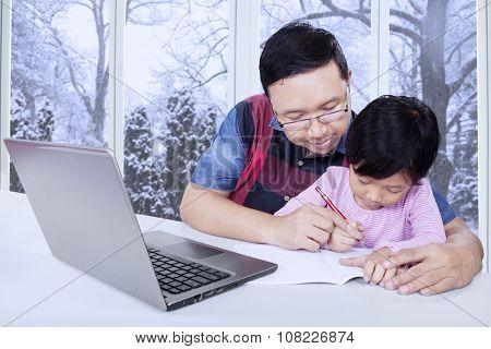 Dad Helps His Daughter Doing School Assignment