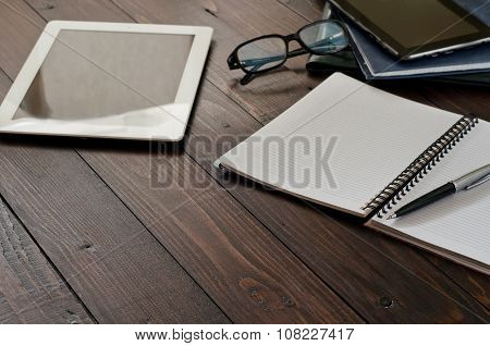 Open Notebook, Tablet Computer, Glasses And Leather Business Folders