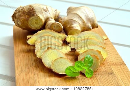 Ginger on a white wooden table.