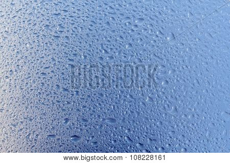 Background of raindrops on glass.