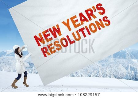 Girl With Winter Coat And A Resolution Banner