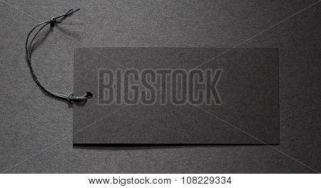Black Tag On Black Paper