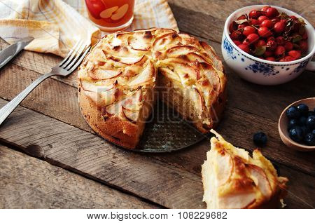 Homemade organic apple pie dessert ready to eat. Delicious and beautiful apple pie on a wooden table