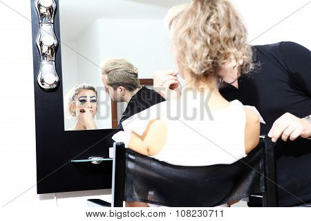 Makeup Artist Applying Lipstick On Model Lips With Brush At Mirror