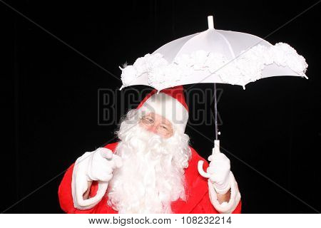 Santa Claus carries an umbrella while checking to see if its going to snow. Santa Claus weather. Christmas Snow. Snow for Christmas. Christmas Eve. Santa loves snow.