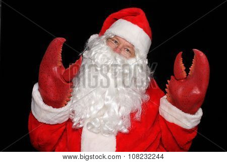 Santa Claus wears Lobster Claw Hands while posing in a PHOTO BOOTH for a funny picture.