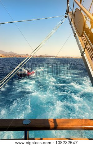 Sailboat near coastline