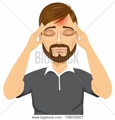 man touching his temples suffering a headache