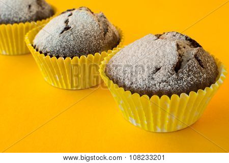 Muffins On Yellow Background