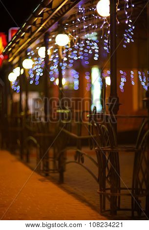 Fences And Blurred Night Lights Decorations Of The Bar On  Background