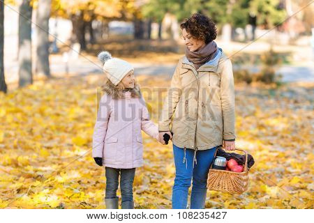 Mother and daughter going to make a picnic