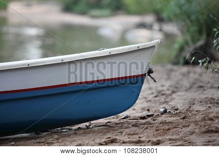 rowing boat on the beach close to