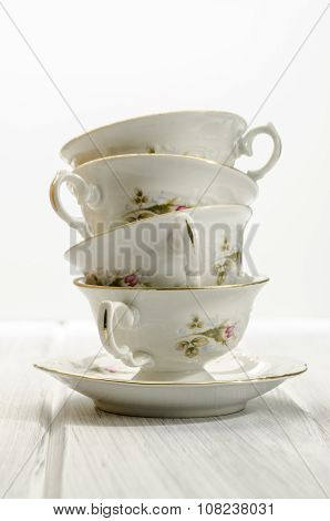 Two Antique Teacups On White Background
