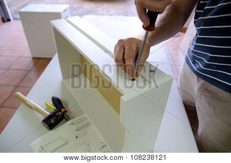 Assembling flatpack cabinet