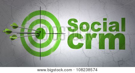 Advertising concept: target and Social CRM on wall background