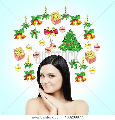 A Portrait Of A Smiling Brunette Who Is Waiting For Christmas And New Year's Eve. Christmas-tree Dec
