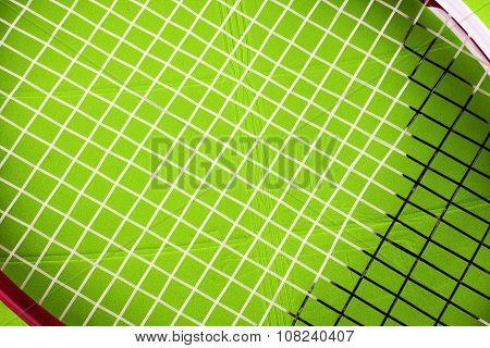 Tennis Racket Over Green Plastic Field