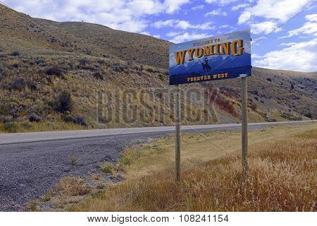 Wyoming Welcome Road sign on interstate