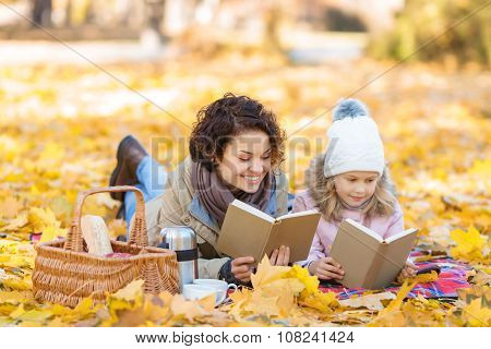 Positive mother and daughter reading books
