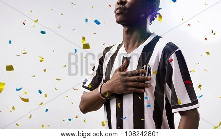 soccer player stand in white background confetti