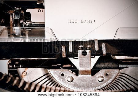 Letter with a title Hey Baby typed on old typewriter