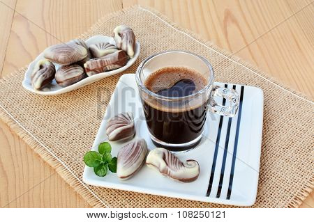 Cup Of Coffee With Chocolate Candy Truffles