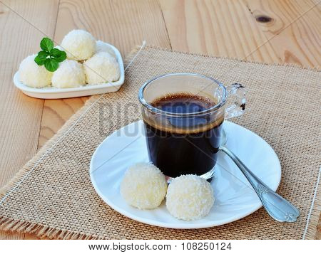 Cup Of Coffee And White Chocolate Candy Truffles With Coconut Sprinkles