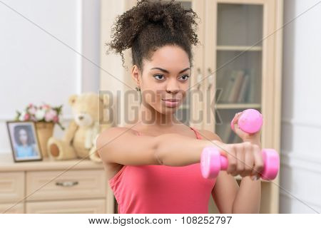 Cheerful girl doing physical exercises
