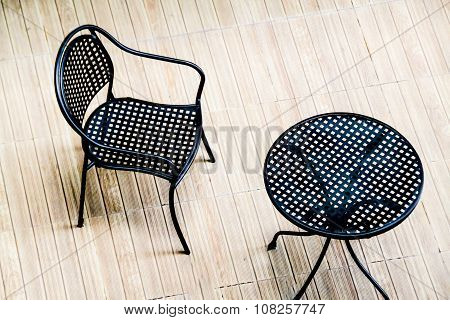 Steel Chair And Table On Wooden Floor : Top View