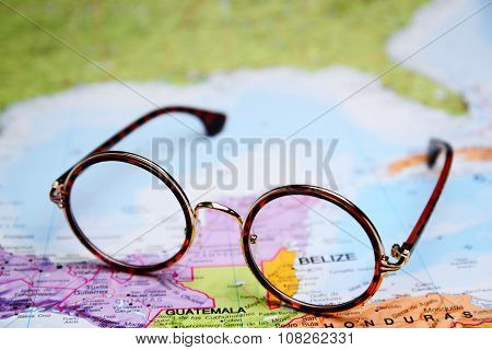 Glasses on a map - Belize