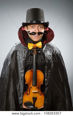 Funny violin player wearing tophat