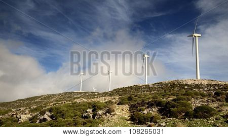 5 wind turbines on a mountains in Naxos, Greece
