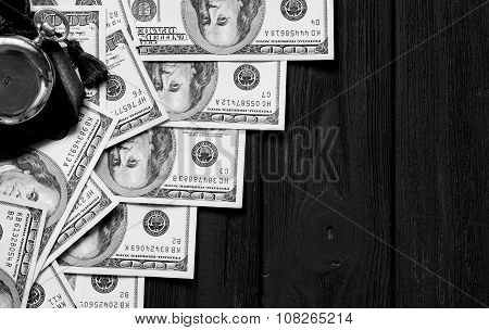 Stack Of Money Dollars Laid Out Like A Ladder With Antique Gold Watch On Black Retro Stylized Wood B