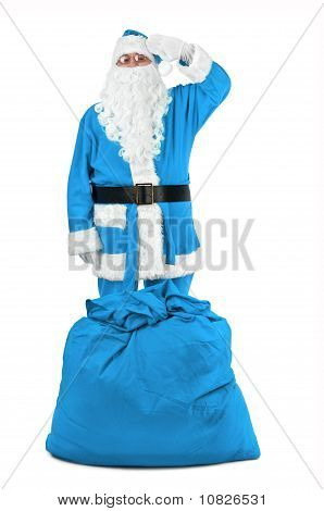 Funny Santa Claus In Blue Costume Salutes