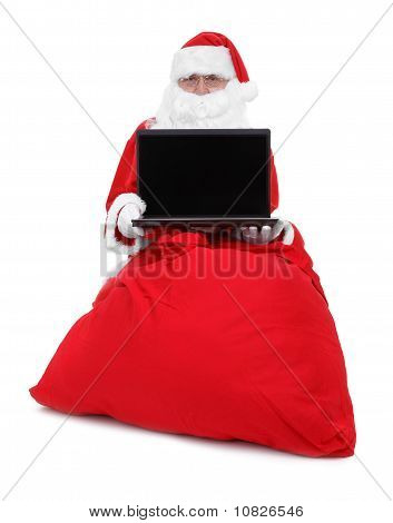 Santa Claus Shows Laptop
