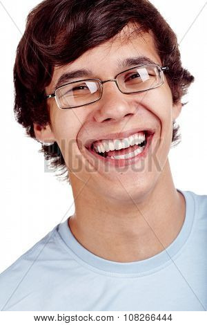 Face close up of young hispanic man wearing glasses and blue t-shirt smiling perfect healthy toothy smile over white background - dentistry or ophthalmology concept