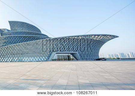 Dong- ying ,Shan dong,China-18,July,2015:view of modern building named Dong ying Snow-Lotus Grand Theater  exterior with empty ground front in blue sky