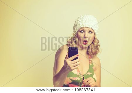 Shocked Young Woman Staring At Her Mobile