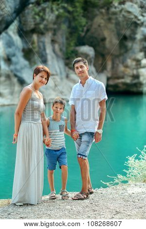 Family With Boy By The River