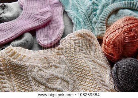 Warm hand made clothes and cotton closeup