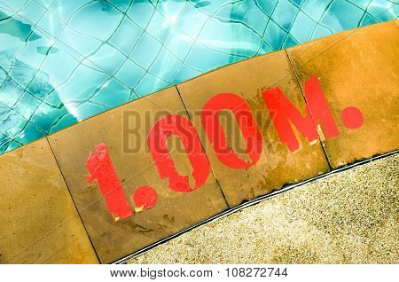 Swimming pool with Number 1.00 on ground at hotel
