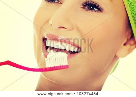 Beautiful caucasian woman with toothbrush.