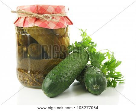 Jar of canned cucumbers isolated on white