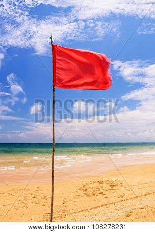 Red warning flag on beach Thailand.