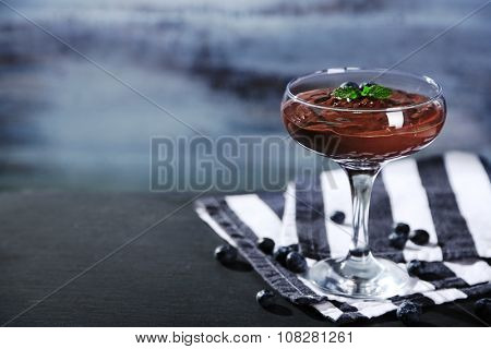 Chocolate mousse with fresh berries on wooden background
