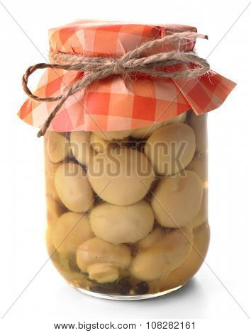 Delicious marinated mushrooms in glass jar isolated on white