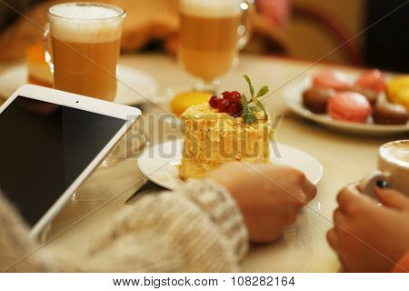 Women meeting in cafe and taking photos of food