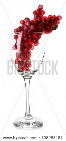 Clean wineglass with grapes, isolated on white
